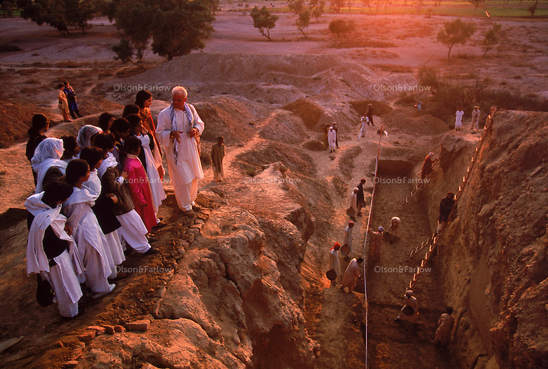 Mark Kenoyer giving a tour to Pakistanis at the great trench, Harappa. 4,800 years ago, at the same time as the early civilizations of Mesopotamia and Egypt, great cities arose along the flood plains of the Indus and Saraswati (Ghaggar-Hakra) rivers.  Developments at Harappa have pushed the dates back 200 years for this civilization, proving once and for all, that this civilization was not just an offshoot of Mesopotamia..They were a highly organized and very successful civilization.  They built some of the world's first planned cities, created one of the world's first written languages and thrived in an area twice as large as Egypt or Mesopotamia for 900 years (1500 settlements spread over 280,000 square miles on the subcontinent)..There are three major communities--Harappa, Mohenjo Daro, and Dholavira. The town of Harappa flourished during this period because of it's location at the convergence of several trade routes that spanned a 1040 KM swath from the northern mountains to the coast.