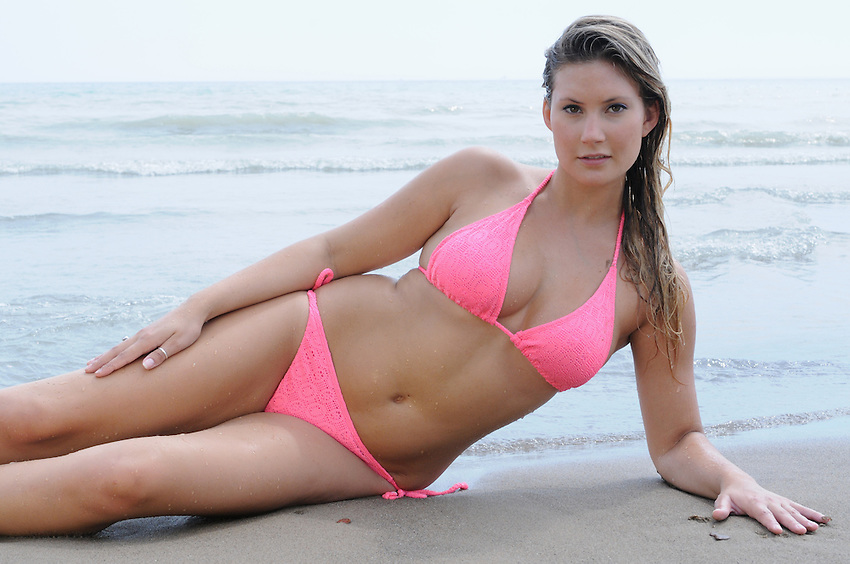 Beautiful woman provacative pose at the beach