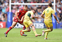 Australia's Sean McMahon is tackled by Wales's Adam Thomas<br /> <br /> Australia Vs Wales - Men's quarter-final<br /> <br /> Photographer Chris Vaughan/CameraSport<br /> <br /> 20th Commonwealth Games - Day 4 - Sunday 27th July 2014 - Rugby Sevens - Ibrox Stadium - Glasgow - UK<br /> <br /> © CameraSport - 43 Linden Ave. Countesthorpe. Leicester. England. LE8 5PG - Tel: +44 (0) 116 277 4147 - admin@camerasport.com - www.camerasport.com