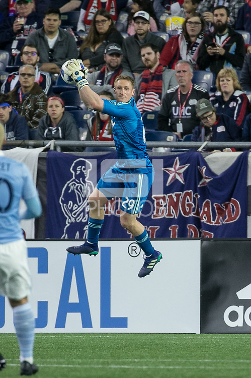 Foxborough, Massachusetts - April 28, 2018:  The New England Revolution (blue) beat Sporting Kansas City (light blue) 1-0 in a Major League Soccer (MLS) match at Gillette Stadium.