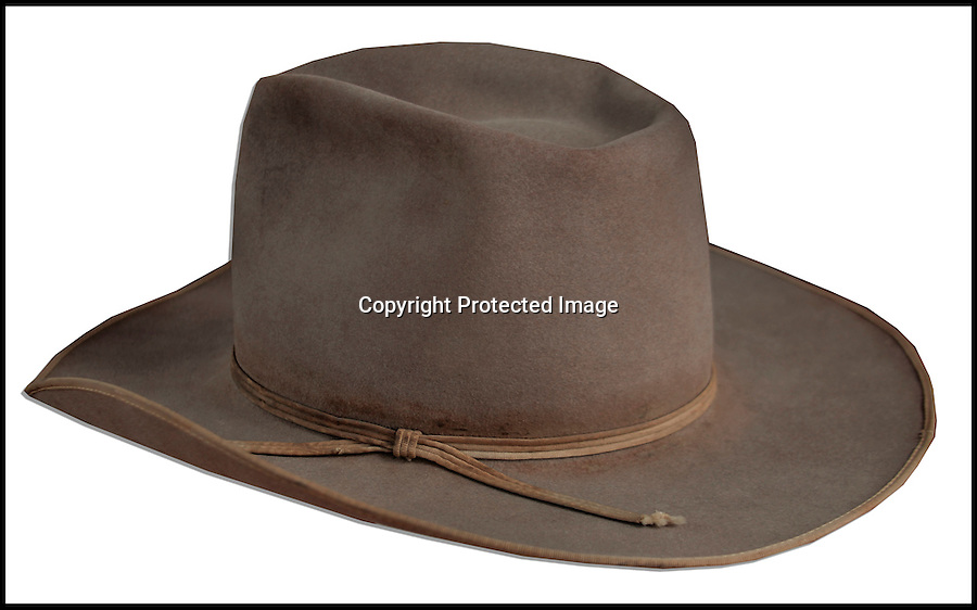 BNPS.co.uk (01202 558833)<br /> Pic: NateD.Sanders/BNPS<br /> <br /> ***Please Use Full Byline***<br /> <br /> John Wayne's Cowboy hat.<br /> <br /> The iconic cowboy hat that John Wayne wore in six major western films has emerged for auction and is set to fetch £17,000.<br /> <br /> The felt accessory was worn by the actor in 'The Comancheros', 'McClintock', 'The Sons of Katie Elder', 'El Dorado', and 'The Undefeated.'<br /> <br /> The famous star burst into Hollywood in 1930 and he featured in around 170 movies throughout his career.<br /> <br /> He worked alongside his stunt double, Chuck Roberson, for more than 30 years and gave him the hat as a present.