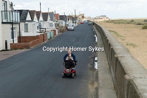 Jaywick Essex Uk. Senior oap female  poverty in coastal town. 2013