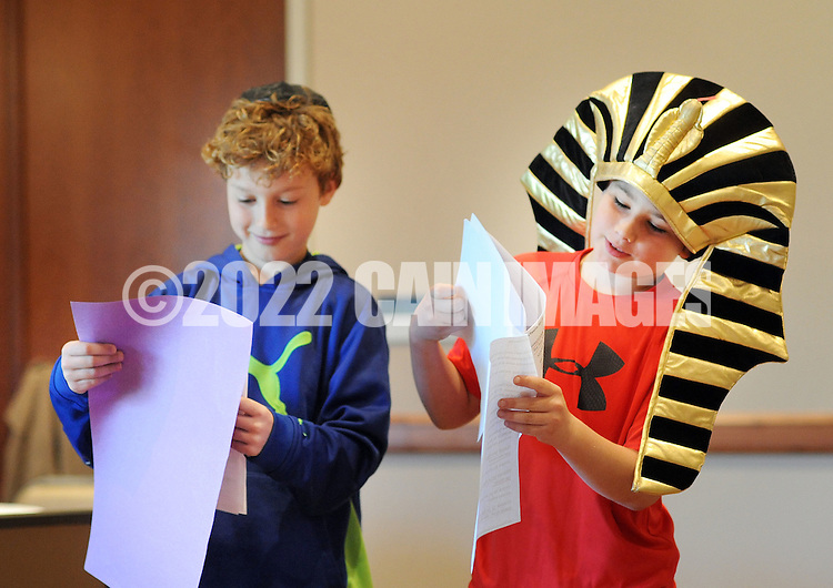 """From left, Ethan Bevington and Ben Seidler as the pharaoh perform """"Let My People Go"""" as they participate in Passover Palozza in preparation for the holiday Sunday April 17, 2016 at Congregation Beth El in Lower Makefield, Pennsylvania. (Photo by William Thomas Cain)"""