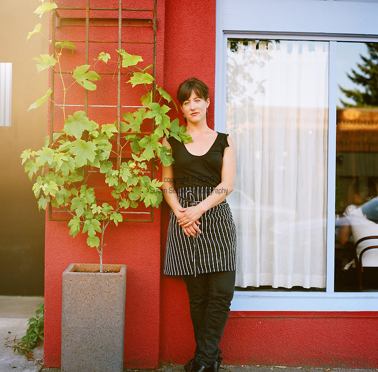 "Beast is a six-course, prix fixe restaurant in NE Portland, Oregon whose menu changes every Wednesday.  Chef (and single mom) Naomi Pomeroy and sous chef Micah Paredes focus on local ingredients in a style which they call ""refined French grandmother.""  Pictured here is Naomi Pomeroy standing just outside the restaurant."