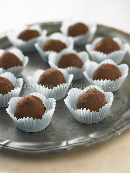 Chocolate truffles in paper cups, on a platter