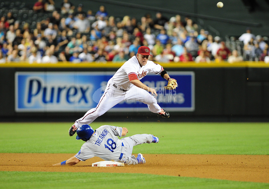 May 21, 2012; Phoenix, AZ, USA; Arizona Diamondbacks second baseman Aaron Hill throws to first base after forcing out sliding Los Angeles Dodgers base runner (18) Matt Treanor in the fourth inning at Chase Field.  Mandatory Credit: Mark J. Rebilas-