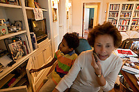 8 year-old Danny Hodes glances at a photograph of the late journalist Don Hewitt as the later's widow Marilyn Berger (R) speaks on the phone in her apartment in New York, NY, USA, 9 April 2010. Ms Berger met him in Addis Ababa, Ethiopia while reporting there and helped him get surgery.