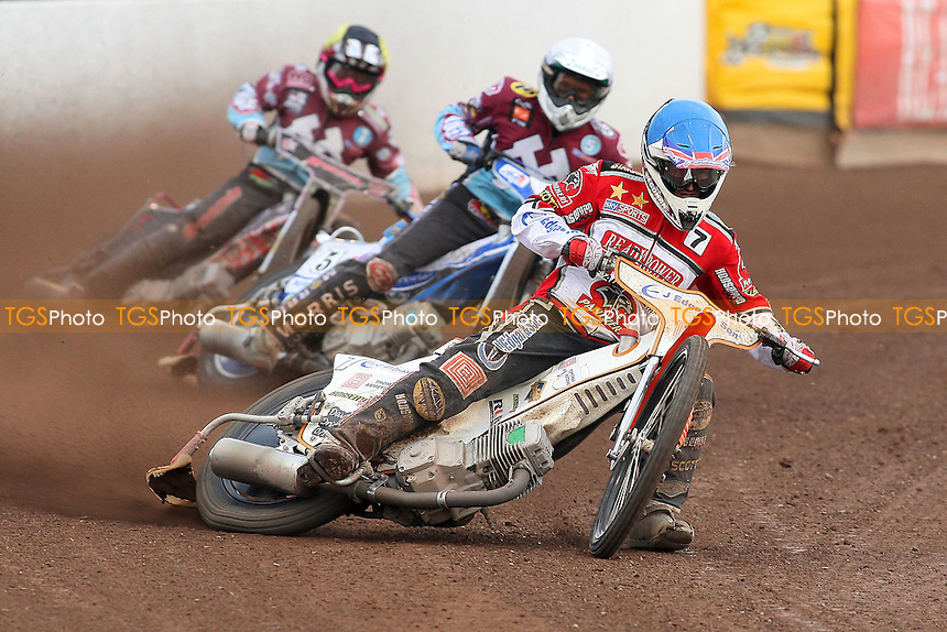 Heat 4: Richard Lawson (blue), Piotr Swiderski (white) and Rob Mear  - Peterborough Panthers vs Lakeside Hammers - Elite League Speedway at the Showground, Peterborough - 18/07/11 - MANDATORY CREDIT: Gavin Ellis/TGSPHOTO - Self billing applies where appropriate - 0845 094 6026 - contact@tgsphoto.co.uk - NO UNPAID USE.