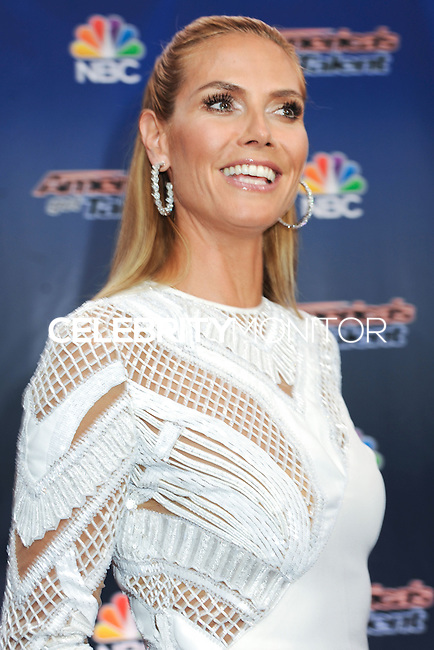 NEW YORK CITY, NY, USA - JULY 29: Heidi Klum arrives at the 'America's Got Talent' Season 9 Pre Show Red Carpet Event held at Radio City Music Hall on July 29, 2014 in New York City, New York, United States. (Photo by Celebrity Monitor)