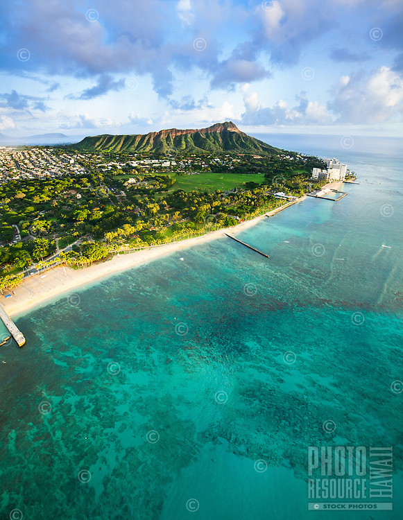 An aerial perspective of Kapi'olani Park and Diamond Head taken from the edge of Waikiki on O'ahu.