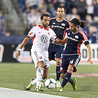 New England Revolution midfielder Lee Nguyen (24) successfully challenges D.C. United forward Dwayne De Rosario (7). In a Major League Soccer (MLS) match, the New England Revolution (blue) defeated D.C. United (white), 2-1, at Gillette Stadium on September 21, 2013.