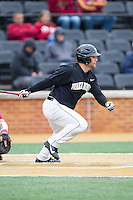 Nate Mondou (10) of the Wake Forest Demon Deacons follows through on his swing against the Florida State Seminoles at Wake Forest Baseball Park on April 19, 2014 in Winston-Salem, North Carolina.  The Seminoles defeated the Demon Deacons 4-3 in 13 innings.  (Brian Westerholt/Four Seam Images)