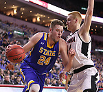 SIOUX FALLS, SD: MARCH 7: Mike Daum #24 of South Dakota State drives toward Mitch Hahn #44 of Omaha during the Men's Summit League Basketball Championship Game on March 7, 2017 at the Denny Sanford Premier Center in Sioux Falls, SD. (Photo by Dick Carlson/Inertia)