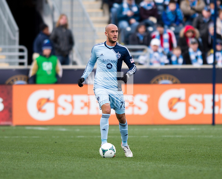 Aurelien Collin (10) of Sporting Kansas City brings the ball upfield during the game at PPL Park in Chester, PA.  Kansas City defeated Philadelphia, 3-1.