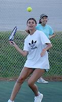 Graham Thomas/Herald-Leader<br /> Trinity Bagley prepares to hit the ball during tennis practice on July 23.