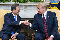 US President Donald J. Trump (R) welcomes Korean President Moon Jae-in (L) to the Oval Office of the White House in Washington, DC, USA, 11 April 2019. President Moon is expected to ask President Trump to reduce sanctions on North Korea in an attempt to jump start nuclear negotiations between North Korea and the US.<br /> CAP/MPI/RS<br /> &copy;RS/MPI/Capital Pictures