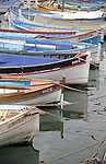 Wooden boats tied to the pier in the old port of the southern riviera town of Nice, France.