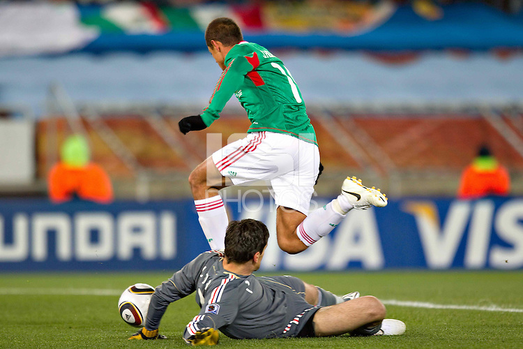 Javier Hernandez of Mexico rounds Hugo Lloris goalkeeper of France to score the opening goal against France.