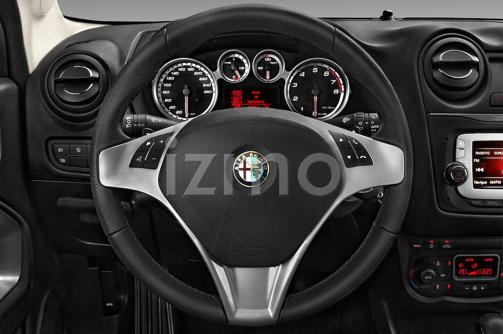 Car pictures of steering wheel view of a 2015 Alfaromeo Mito 600H-L-President-Line 4 Door Sedan Steering Wheel