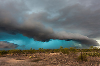 Shelf cloud from a thunderstorm w/ a glowing blue precipitation core in West Texas, May 24, 2014