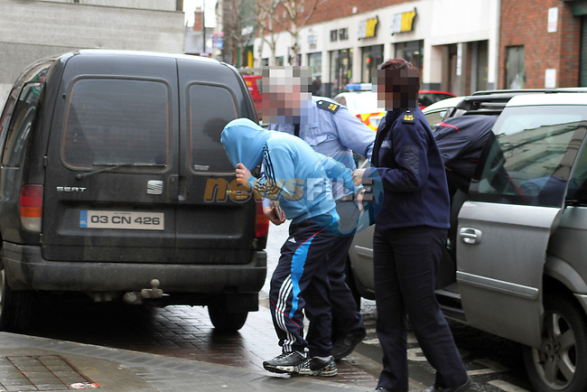 34 year old Darren Cuneen, from Clare Street in Limerick and 19 year old Jason Cuneen, from Hospital, Co Limerick, arriving at Drogheda Court accused of having a 'Mark 3 Sten' machine gun in Drumleek, Castlebellingham, Co Louth on January 19th...(Photo credit should read Jenny Matthews www.newsfile.ie)....This Picture has been sent you under the conditions enclosed by:.Newsfile Ltd..The Studio,.Millmount Abbey,.Drogheda,.Co Meath..Ireland..Tel: +353(0)41-9871240.Fax: +353(0)41-9871260.GSM: +353(0)86-2500958.email: pictures@newsfile.ie.www.newsfile.ie.