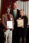 President Nellis presents Douglas Goetz and Kelly McCall their patent awards.