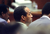 Former NFL star running back O.J. Simpson looks on during his trial of  for the murder of his former wife, Nicole Brown Simpson and a friend of hers, restaurant waiter, Ron Goldman in Los Angeles County Superior Court in Los Angeles, California on July 13, 1995.<br /> Credit: Steve Grayson / Pool via CNP