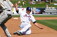 New York Mets Brad Emaus #68 slides into third base during an exhibition game vs the Michigan Wolverines at Digital Domain Ballpark in Port St. Lucie, Florida;  February 27, 2011.  New York defeated Michigan 7-1.  Photo By Mike Janes/Four Seam Images