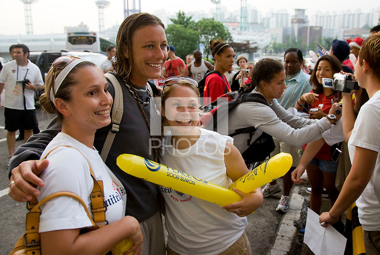 USWNT forward Abby Wambach poses for a picture with fans following the game. The USWNT defeated Italy, 2-0, at the Suwon Sports Center in Suwon, South Korea.