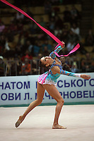 "Evgenia Kanaeva of Russia performs with ribbon at 2008 World Cup Kiev, ""Deriugina Cup"" in Kiev, Ukraine on March 22, 2008."