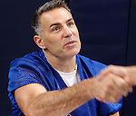 Kurt Warner shakes hands with a fan after signing autographs for him before the game.