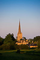 Burford Church with spire in Cotswolds setting sun landscape rural scene, Burford, The Cotswolds, Oxfordshire