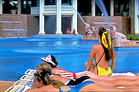 Women, Sunning, relaxing, bathing suits, swimming pool