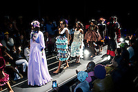 SOWETO, SOUTH AFRICA MAY 29: Models for the designer Urban Zulu walks with garments during a fashion show at Soweto Fashion Week on May 29, 2014 at the Soweto Theatre in the Jabulani section of Soweto, South Africa. Local emerging designers showed their collections during the three-day event held at the theatre. Founded in 2012, Soweto fashion week gives a platform to local designers, models and artists. (Photo by: Per-Anders Pettersson)