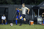 Alistair Johnston (8) of the Wake Forest Demon Deacons pushes the ball up the field during first half action against the Duke Blue Devils at W. Dennie Spry Soccer Stadium on September 29, 2018 in Winston-Salem, North Carolina.  The Demon Deacons defeated the Blue Devils 4-2.  (Brian Westerholt/Sports On Film)