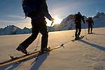 A group of skiers traverse the Mont Collon Glacier, Haute Route, Switzerland.