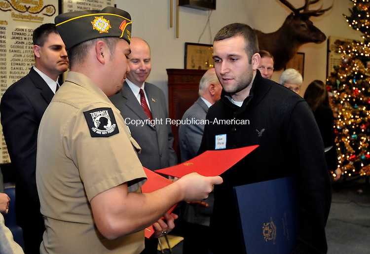 NAUGATUCK, CT-05 DECEMBER 2009-120509JS01-Lance Cpl. Joshua A. Hott, right, receives a citation from Chris Walsh, Commander, VFW Post 1946 during a ceremony honorisn Naugatuck's Veterans of Iraq and Afghanistan held Saturday at the Naugatuck Elks Lodge. The event was sponsored by VFW Post 1946 and Rep. Rosa C. Rebimbas, R-Naugatuck.<br /> Jim Shannon Republican-American