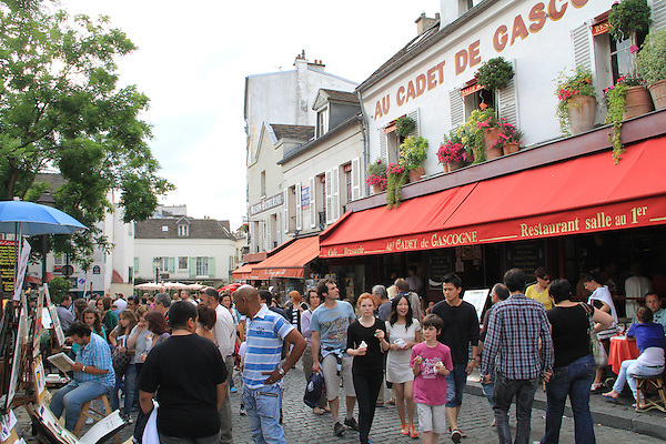 Tourists and street vendors in the Montmartre neighborhood, Paris, France.