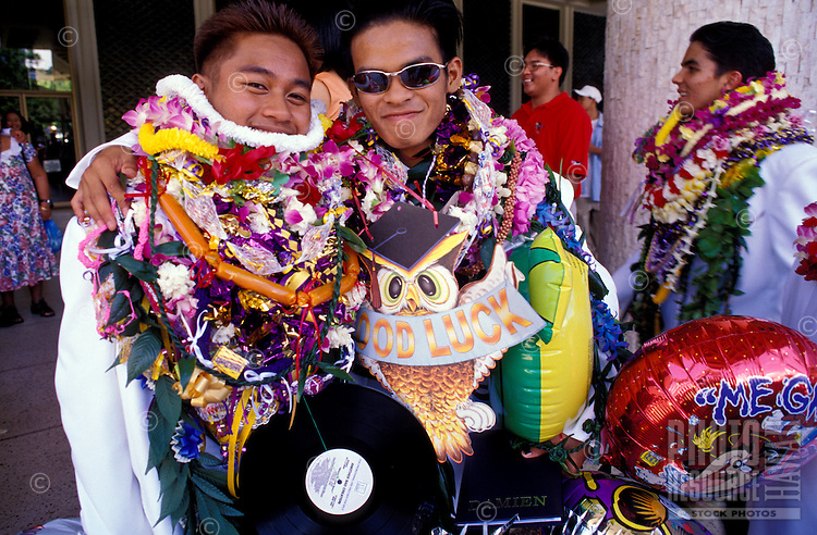 High school graduates bedecked with colorful leis after the graduation ceremony at the Blaidell Concert Hall, Honolulu
