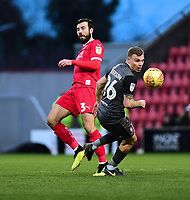 Lincoln City's Harry Anderson vies for possession with  Swindon Town's Michael Doughty<br /> <br /> Photographer Andrew Vaughan/CameraSport<br /> <br /> The EFL Sky Bet League Two - Swindon Town v Lincoln City - Saturday 12th January 2019 - County Ground - Swindon<br /> <br /> World Copyright &copy; 2019 CameraSport. All rights reserved. 43 Linden Ave. Countesthorpe. Leicester. England. LE8 5PG - Tel: +44 (0) 116 277 4147 - admin@camerasport.com - www.camerasport.com