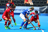 Scotland's Lee Morton is closed down by Namyong Lee and Mookyoung Lee of Korea in midfield during the Hockey World League 9th and 10th placing match between Korea and Scotland at the Olympic Park, London, England on 22 June 2017. Photo by Steve McCarthy.