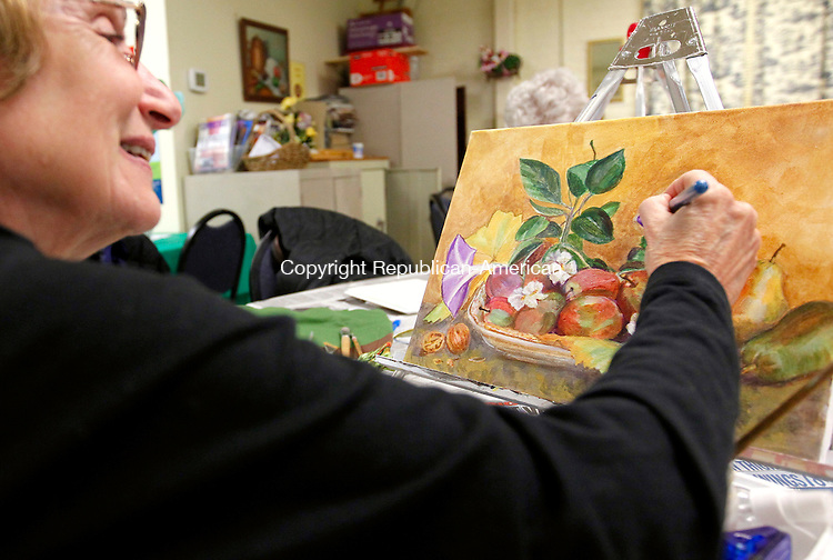 "Naugatuck, CT-05 March 2012-030512CM01-  Judy Cousens works on her painting titled, ""Bountiful Fruit"" during an art class at the Naugatuck Senior Center Monday afternoon.  The class, taught by Judy Jaworski, was working with acrylic paint.  The class meets every Monday afternoon from 1-3pm at the Senior Center.   Christopher Massa Republican-American"