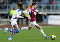 Burnley's Robbie Brady under pressure from Crystal Palace's Wilfried Zaha<br /> <br /> Photographer Rich Linley/CameraSport<br /> <br /> The Premier League - Burnley v Crystal Palace - Saturday 30th November 2019 - Turf Moor - Burnley<br /> <br /> World Copyright © 2019 CameraSport. All rights reserved. 43 Linden Ave. Countesthorpe. Leicester. England. LE8 5PG - Tel: +44 (0) 116 277 4147 - admin@camerasport.com - www.camerasport.com