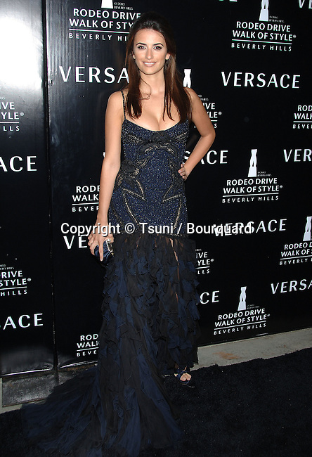 Penelope Cruz arriving at the WALK OF STYLE Awards to Versace at the City Hall in Beverly Hills.<br /> <br /> <br /> full length<br /> smile<br /> dark bluek dress<br /> eye contact