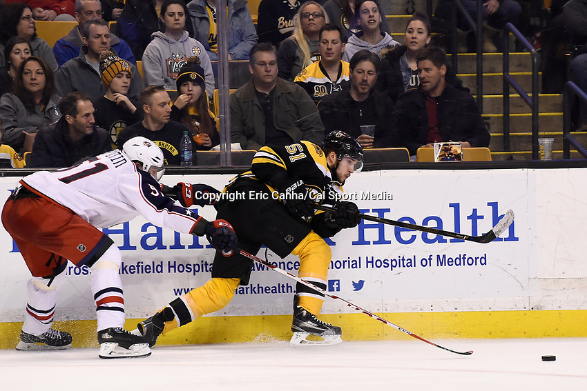 Monday, February 22, 2016: Boston Bruins center Ryan Spooner (51)(R) passes the puck as Columbus Blue Jackets defenseman Fedor Tyutin (51) (L) tries to block the pass during the National Hockey League game between the Columbus Blue Jackets and the Boston Bruins, held at TD Garden, in Boston, Massachusetts. The Blue Jackets defeat the Bruins 6-4. Eric Canha/CSM