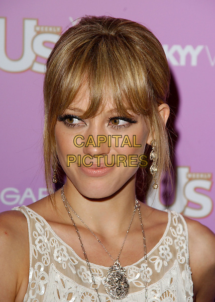 HILARY DUFF.Attends The US Weekly Young Hollywood Hot 20 Party held at LAX in Hollywood,.Los Angeles, 16th September 2005.portrait headshot white cream lace embroidered dress fringe.Ref: DVS.www.capitalpictures.com.sales@capitalpictures.com.Supplied By Capital PIctures