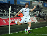 Pictured: George Byers of Swansea City takes a corner kick Monday 15 May 2017<br />