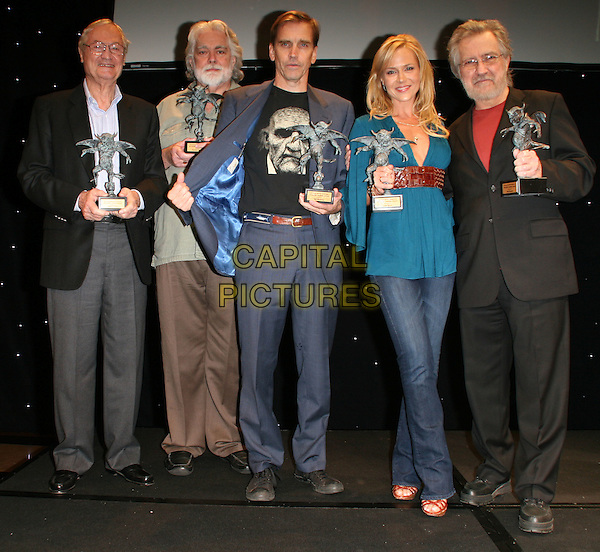 ROGER CORMAN, GUNNAR HANSEN, BILL MOSELEY, JULIE BENZ & TOBE HOOPER .6Th Annual Eyegore Awards during Universal Studios Horror Fest  held at Universal Studios, Hollywood, California, USA..October 3rd, 2008.full length black awards trophy trophies black suit glasses beard facial hair jeans denim blue teal top suit.CAP/ADM/KB.©Kevan Brooks/AdMedia/Capital Pictures.