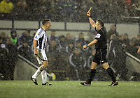 Pictured: Nicky Shorey of West Bromwich (L) sees a yellow card by match referee Jonathan Moss (R). Saturday, 04 February 2012<br />