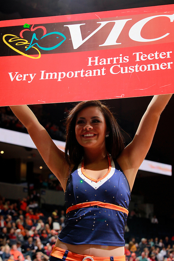 CHARLOTTESVILLE, VA- December 3: The Virginia Cavalier dance team holds up a Harris Teeter grocery store Vic card during the game on December 27, 2011 against the Longwood Lancers at the John Paul Jones Arena in Charlottesville, Virginia. Virginia defeated Longwood 86-53. (Photo by Andrew Shurtleff/Getty Images) *** Local Caption ***